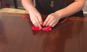 attach collar ribbon onto bow